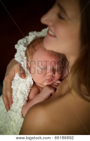 mother holding a baby sleep