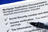 The documents required in a mortgage application isolated on blue poster