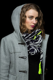 Fashionable Woman In A Grey Hooded Coat