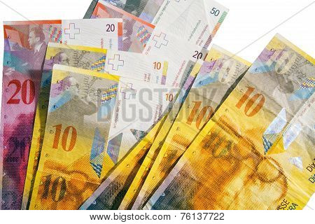Circulated Swiss Francs Currency On White