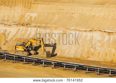 A small excavator at parked in a lignite pit mine poster