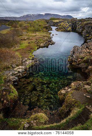 Lake Full Of Coins In Pingvellir National Park, Iceland