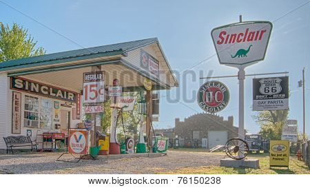 PARIS SPRINGS, MO/USA - MAY 7, 2013: Gay Parita Sinclair gas station on Route 66, owned by Gary Turner. Vintage Sinclair, Penzoil, S&H Green Stamps Wonder Bread and Dunlop signs. ** Note: Soft Focus at 100%, best at smaller sizes