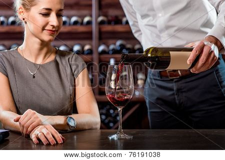Sommelier with young woman on degustation in the cellar
