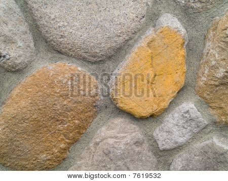 Rock and Concrete Wall with Large Rounded Stones poster