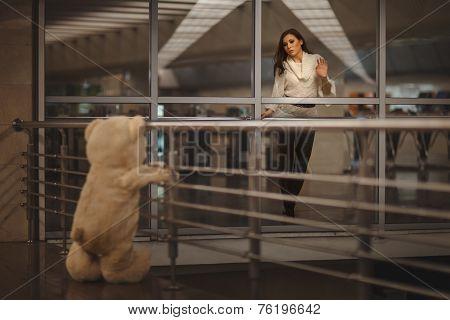 Girl Says Goodbye With A Teddy Bear.