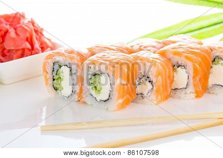 Sushi Roll On White Plate With Ginger