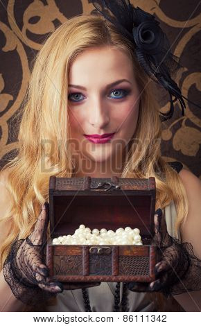Beautiful Retro Woman Opeing A Chest With Jewelry