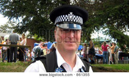 Policeman/sergeant wearing uniform smiling