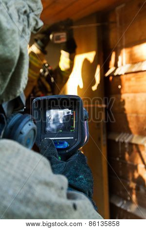 Fireman Inspect With Infrared Camera