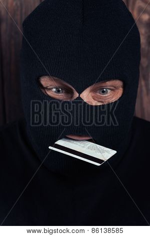 Hacker Holding A Credit Card