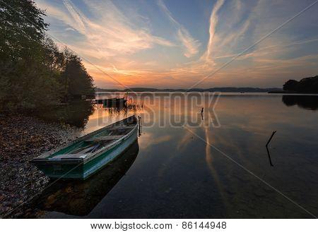 Sunset Lake With Fisherman Boat Landscape.