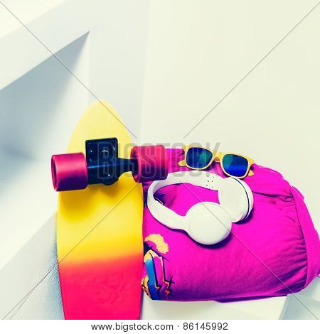 Extreme Sports Accessories. Skateboard And Bright Fashionable Clothes.