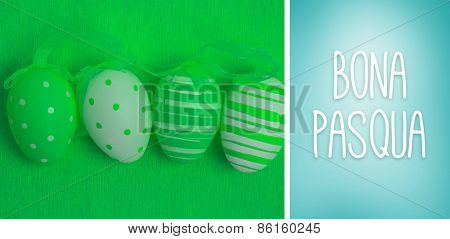 Bona pasqua against blue vignette background