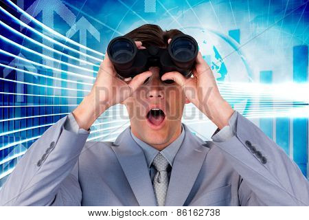 Suprised businessman looking through binoculars against arrow graphics in blue and white