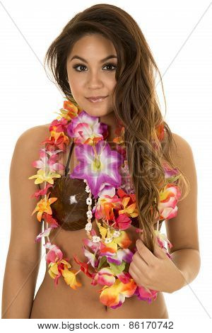 A Hawaiian woman in her coconut bra with her lei around her neck with a small smile. poster