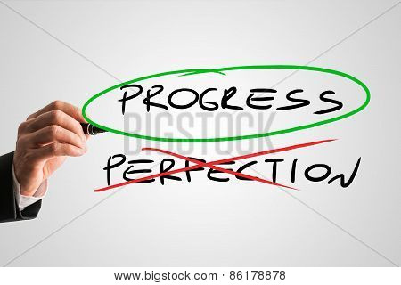 Progress - Perfection concept with a businessman crossing through the handwritten word Perfection in red while ringing Progress in green conceptual of sacrificing perfection to develop and progress. poster