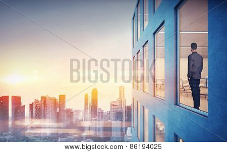 Businessman Is Looking At City