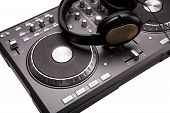 odern grey Dj mixer isolated on white background with headphones poster