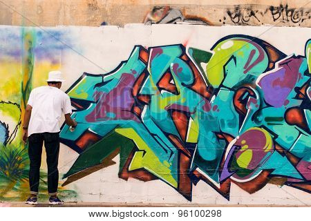 Bangkok Thailand : July 8 : Young Thai Boy Color Spray Bottle Painting Graffiti Art On Side Road Wal