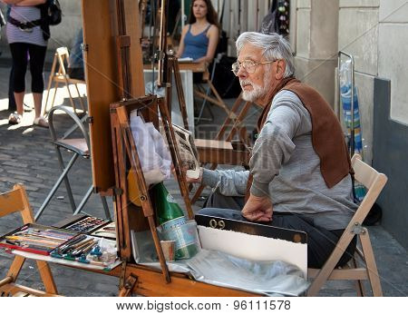 Painter And His Easel At Place Du Tertre In Montmartre Of Paris