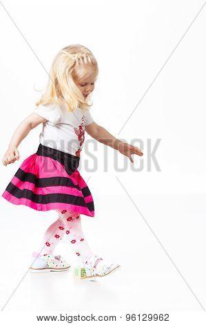 Happy little girl dancing