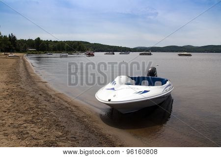 Starfresh recreational boat with a mercury engine on a beach of Maskinongé Lake, Quebec, Canada at s