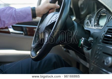 Young elegant man is driving his transport