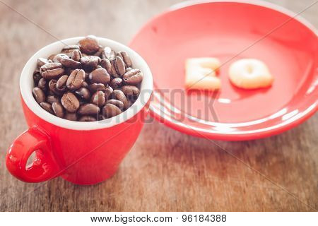 Eq Alphabet Biscuit With Red Coffee Cup