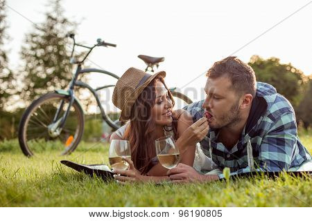 Pretty young lovers are dating in the park