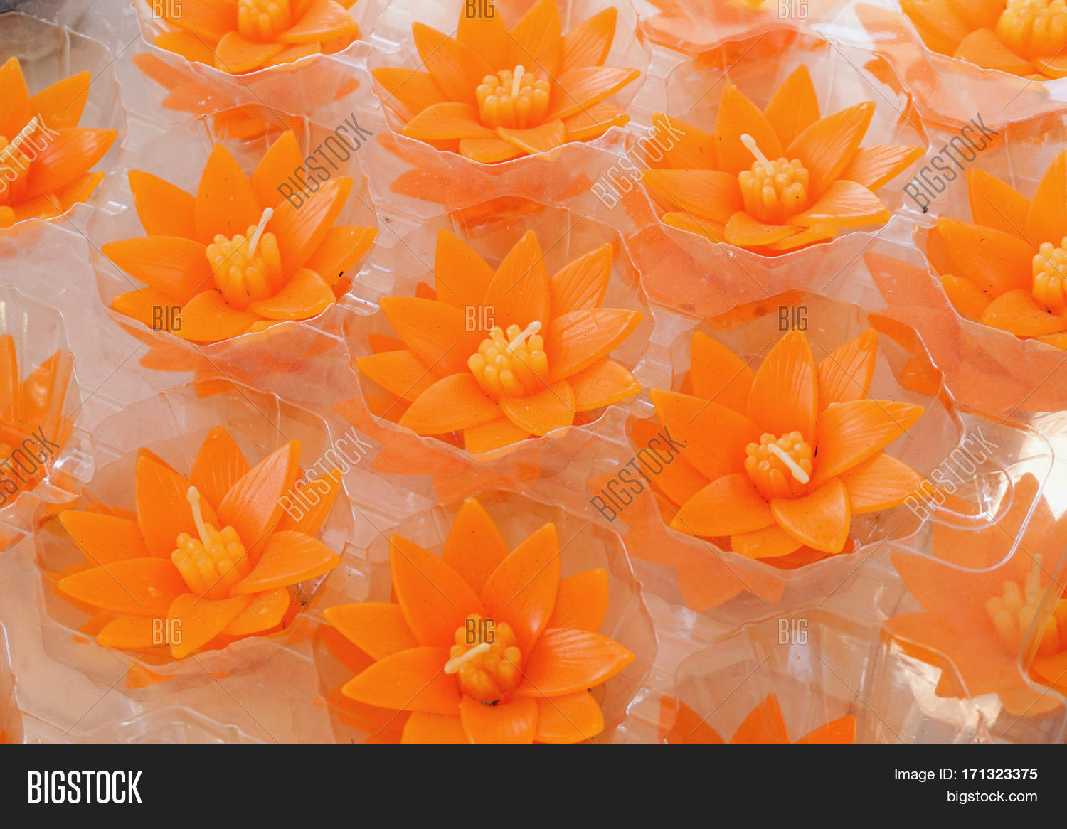 Small carved orange lotus flower image photo bigstock small carved orange lotus flower shape candles for make merit in buddhist thai temple izmirmasajfo