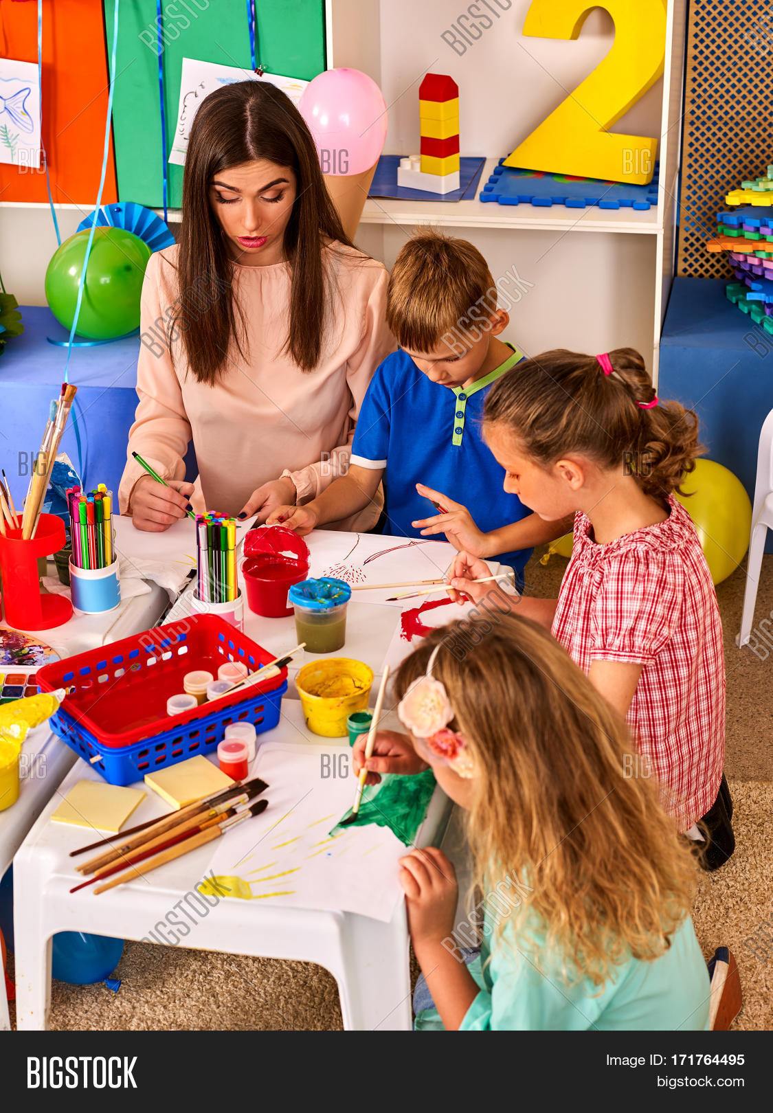 children painting and drawing in kids club craft lesson in primary school kindergarten teacher - Children Painting Pictures