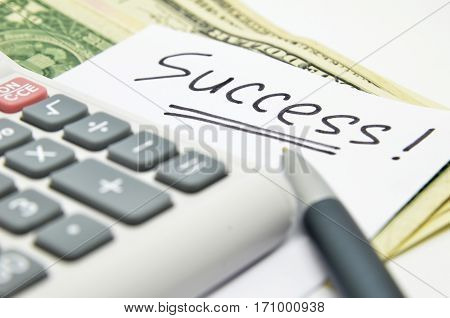 Calculator money and success word on white background