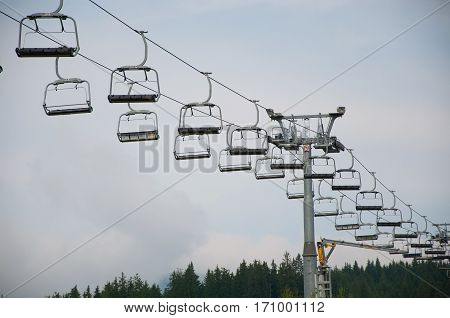 Ski lift in the fall on a sky background