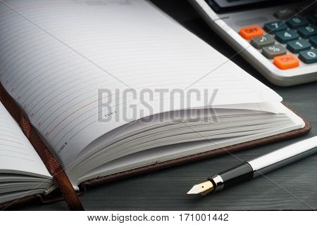 Notepad on dark table. table document bussines,