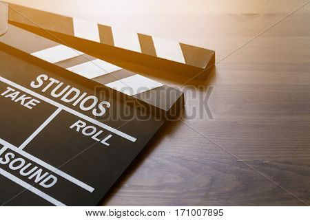movie clapper on wood table top view