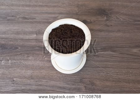 White pot on a floor full whit soil