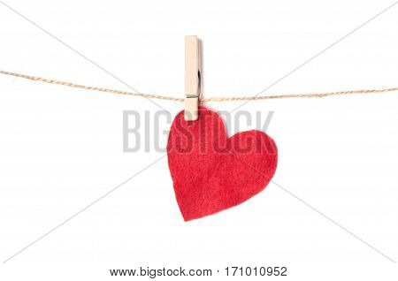 Hearts on a rope with clothespins isolated