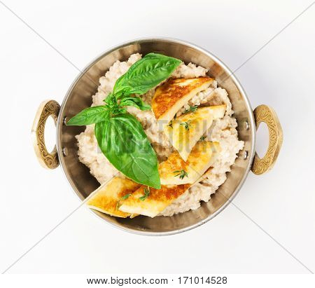 Vegan and vegetarian dish, oatmeal porridge and omelette isolated on white background, top view. Indian restaurant healthy meal, eggs and cereal