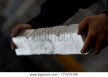 Stack Of Raw Aluminum Ingots In Aluminum Profiles Factory