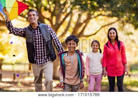 Happy family playing with kite at park