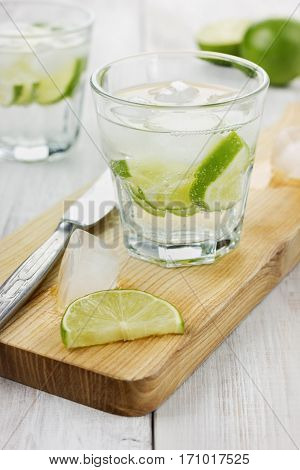 Water with ice and limes. Natural citrus homemade lemonade. Well to quench your thirst in hot weather.