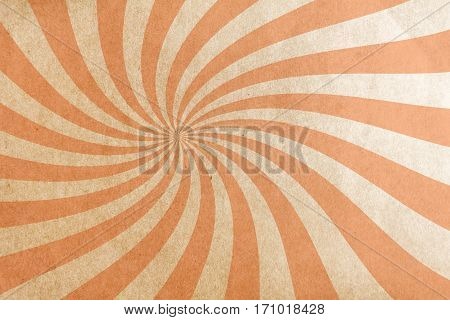Vintage cardboard texture with a orange grinder.