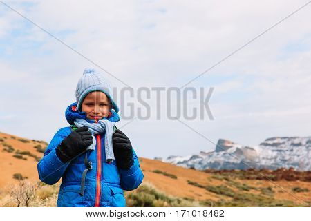 happy little boy with backpack travel in mountains, family travel