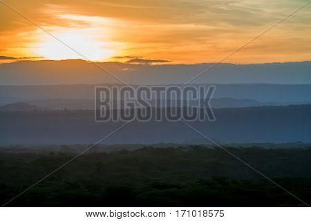 Beautiful panoramic view of vibrant sunrise in savanna