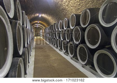 Oak barrels with wine in the cellars of the Sunny Valley winery Crimea. Crimea.
