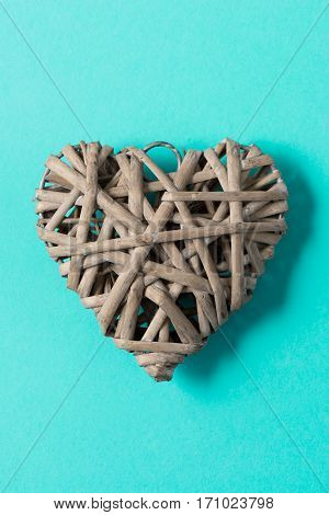 Woven Wicker Heart Over Green Background For Valentine's Mother's Day
