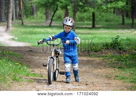 Bicycle Accident. Kids Safety Concept. Boy Transporting His Bike To Repair Place.