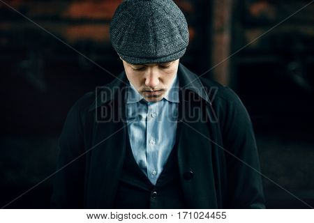 Stylish Gangster In Retro Outfit Posing On Background Of Railway. England In 1920S Theme. Fashionabl