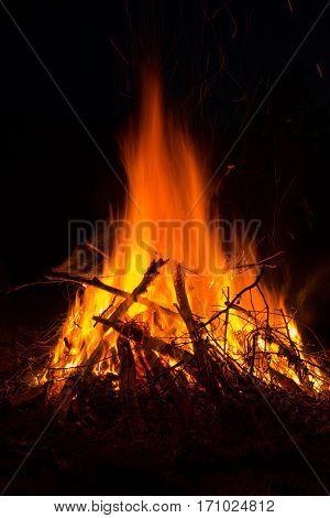 avid blazing bonfire night shot in the dark